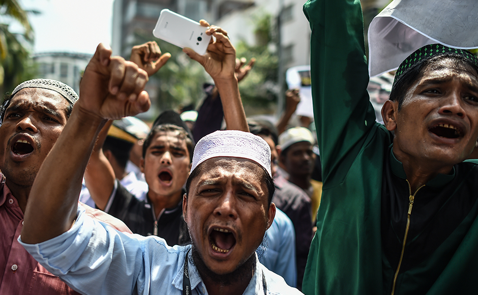 "Myanmar ethnic Rohingya Muslim people living in Malaysia shout slogans during a protest against the persecution of Rohingya Muslims in Myanmar, outside the Myanmar embassy in Kuala Lumpur on July 15, 2016. The European Parliament on July 8 urged Myanmar to end what it termed ""brutal repression"" and ""systematic persecution"" against the country's Rohingya Muslim minority. / AFP PHOTO / MOHD RASFAN"