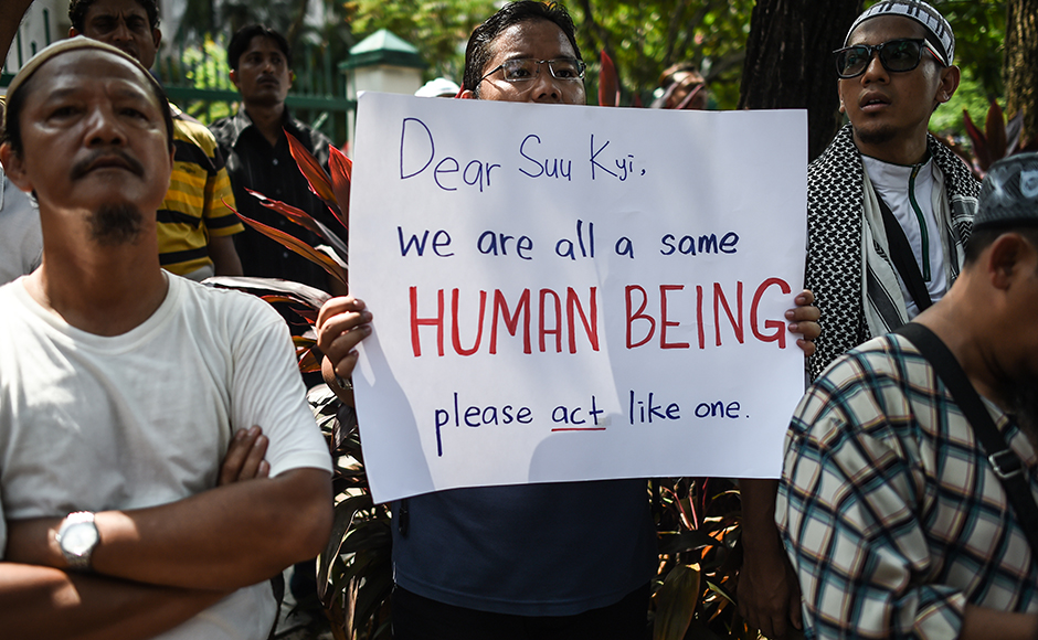 "A protestor displays a placard during a protest against the persecution of Rohingya Muslims in Myanmar, outside the Myanmar embassy in Kuala Lumpur on July 15, 2016. The European Parliament on July 8 urged Myanmar to end what it termed ""brutal repression"" and ""systematic persecution"" against the country's Rohingya Muslim minority. / AFP PHOTO / MOHD RASFAN"