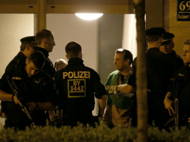 Police search for the suspect after Munich shooting rampage. Reuters
