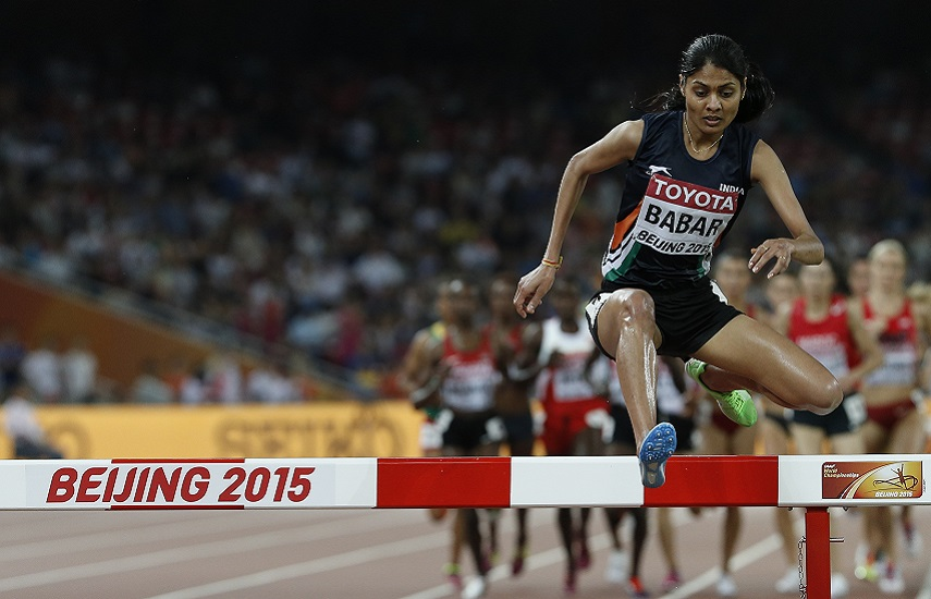 """India's Lalita Shivaji Babar competes in the final of the women's 3000 metres steeplechase athletics event at the 2015 IAAF World Championships at the """"Bird's Nest"""" National Stadium in Beijing on August 26, 2015. AFP PHOTO / ADRIAN DENNIS / AFP PHOTO / ADRIAN DENNIS"""