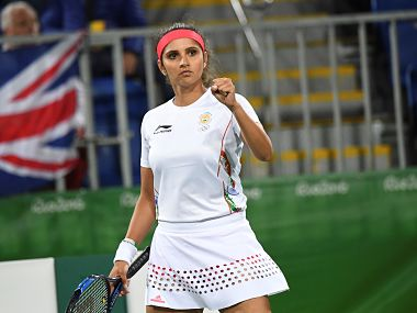 India's Sania Mirza reacts after winning a point against Britain's Heather Watson and Britain's Andy Murray. AFP