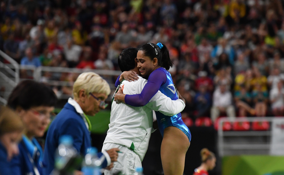India's Dipa Karmakar (R) embraces her coach after competing in the women's vault event final of the Artistic Gymnastics at the Olympic Arena during the Rio 2016 Olympic Games in Rio de Janeiro on August 14, 2016. Ben STANSALL / AFP