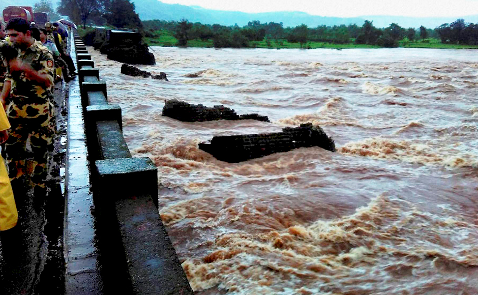 """Officials told media that flooding of the river Savitri could be the reason behind the collapse. However, NDRF DG also said that rescue operations will be hampered due to continuous rainfall. """"Heavy rains are likely to hamper rescue operations. We hope conditions improve when our teams reach the collapse site,"""" he said."""