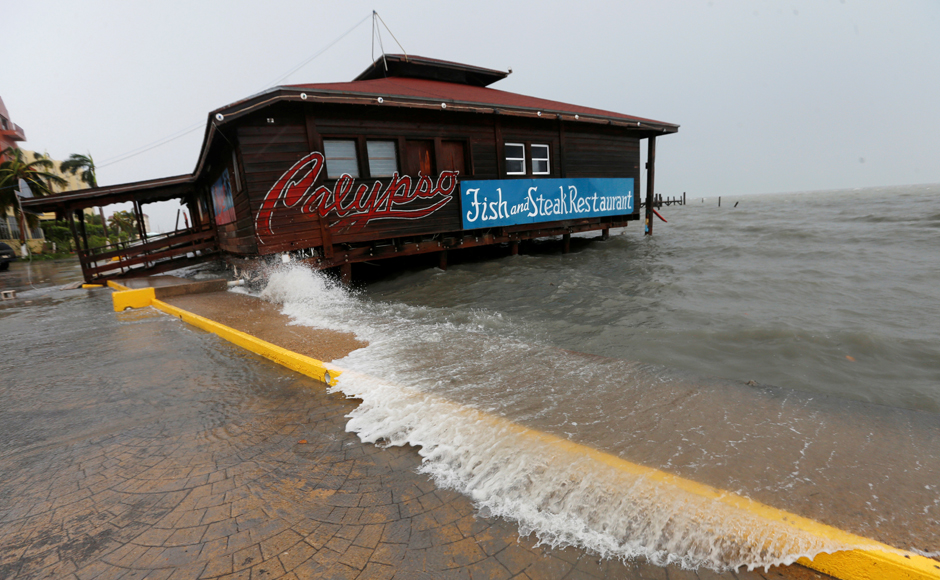 A large wave splashes onto a restaurant along the beach, after Hurricane Earl hits, in Belize City, Belize. REUTERS/Henry Romero