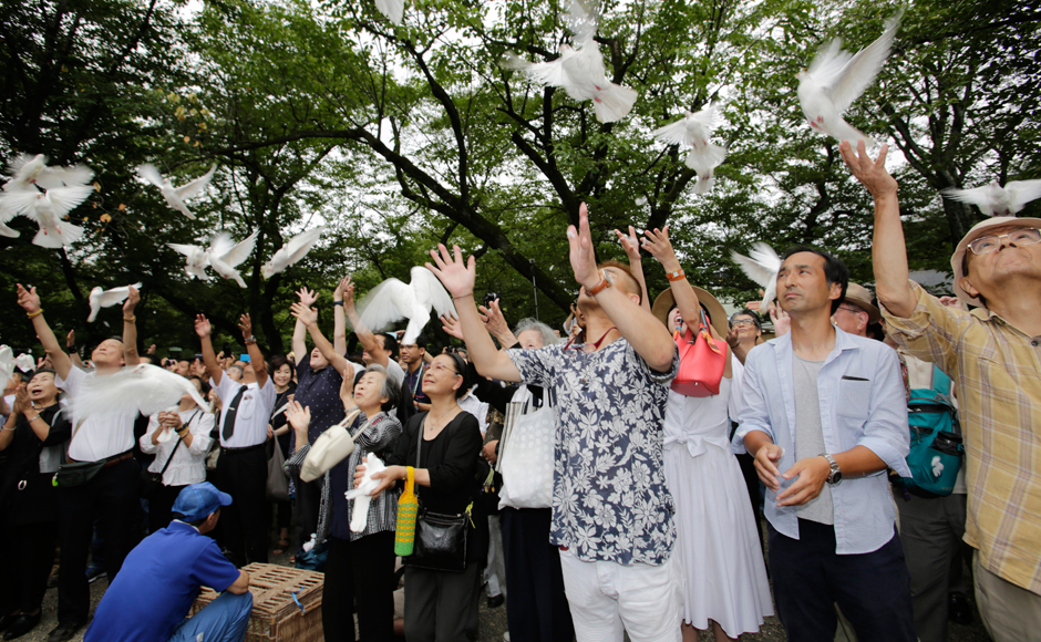 Worshippers release doves, wishing for the world's peace, at the Yasukuni Shrine in Tokyo Monday, Aug. 15, 2016. Japan marked the 71st anniversary of the end of World War II. AP