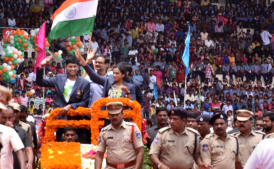 P.V.Sindhu and coach Pullela Gopichand being welcomed by people at Gachibowli stadium in Hyderabad. PTI