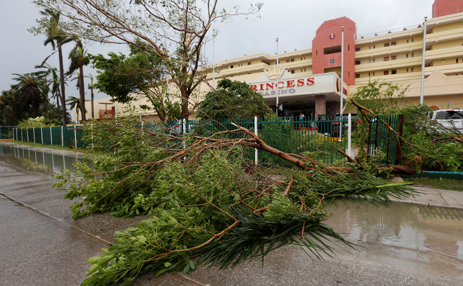 Fallen trees are seen outside of a hotel, after Hurricane Earl hits, in Belize City, Belize. REUTERS/Henry Romero