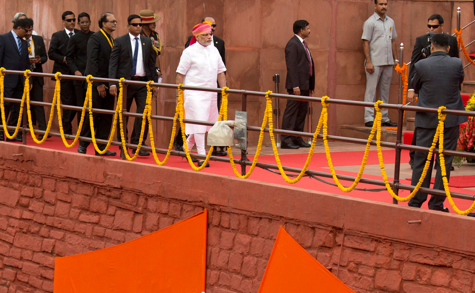 Indian Prime Minister Narendra Modi, center, arrives at the rampart of the historical Red Fort to address the nation on Independence Day in New Delhi, India, Monday, Aug. 15, 2016. India commemorated its Independence in 1947 from British colonial rule, on Aug. 15. AP