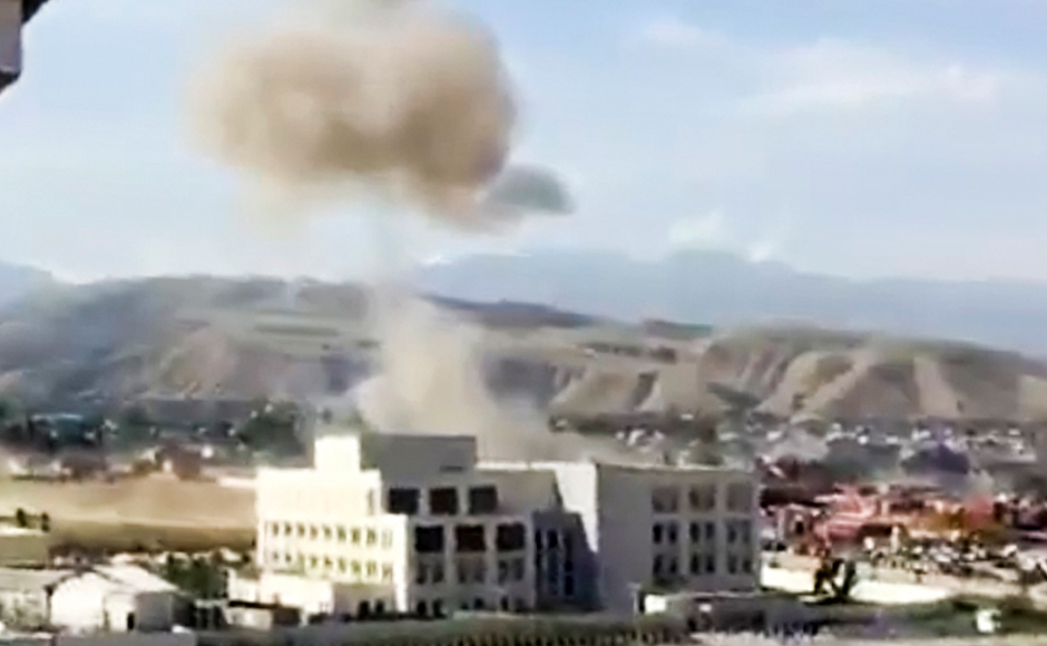 In this image made from a video provided by the Kloop Media Foundation, smoke rises above the Chinese Embassy in Bishkek, Kyrgyzstan, Tuesday, Aug. 30, 2016. A suspected suicide bomber on Tuesday crashed a car through the entrance of the Chinese Embassy in the Kyrgyzstan capital of Bishkek, detonating a bomb that killed the attacker and wounded embassy employees.AP