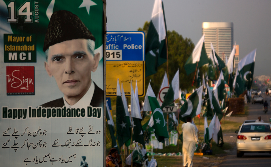 A portrait of Mohammad Ali Jinnah, founder of Pakistan displays at a roadside where vendors selling national flags, badges ahead of Pakistan Independence Day in Islamabad, Pakistan, Friday, Aug. 12, 2106. Pakistani nation will celebrate its 70th Independence Day on Aug. 14, 2016. AP