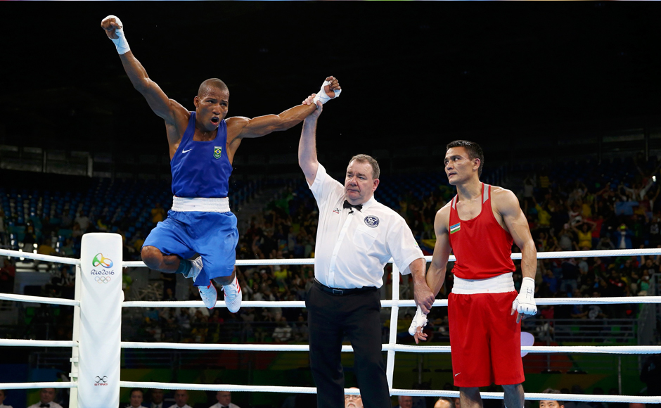 2016 Rio Olympics - Boxing - Quarterfinal - Men's Light (60kg) Quarterfinals Bout 136 - Riocentro - Pavilion 6 - Rio de Janeiro, Brazil - 12/08/2016. Robson Conceicao (BRA) of Brazil celebrates after winning his bout against Hurshid Tojibaev (UZB) of Uzbekistan. REUTERS/Peter Cziborra FOR EDITORIAL USE ONLY. NOT FOR SALE FOR MARKETING OR ADVERTISING CAMPAIGNS.