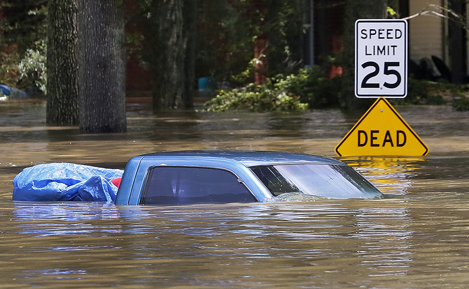 A submerged vehicle is seen in Ascension Parish, Louisiana, U.S., August 15, 2016. REUTERS