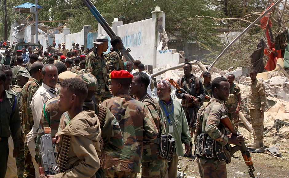 Somali soldiers gather following a blast near the presidential palace in the capital Mogadishu, Somalia Tuesday, Aug. 30, 2016. A suicide bomber has detonated an explosives-laden truck near the gate of Somalia's presidential palace in the capital on Tuesday, killing at least five people, police say.AP