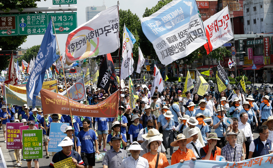 "Thousands of protesters march to oppose a plan to deploy an advanced U.S. missile defense system called Terminal High-Altitude Area Defense, or THAAD, in Seoul, South Korea, Monday, Aug. 15, 2016. The advanced U.S. missile defense system will be deployed in a rural farming town in southeastern South Korea, Seoul officials announced last month, angering not only North Korea and China but also local residents who fear potential health hazards that they believe the U.S. system might cause. The signs read: ""Oppose a deployment of the THAAD."" AP"