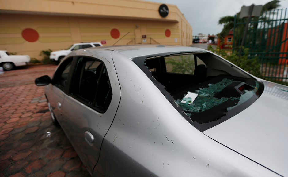 Broken glass is seen in a car, after Hurricane Earl hits, in Belize City, Belize. REUTERS/Henry Romero