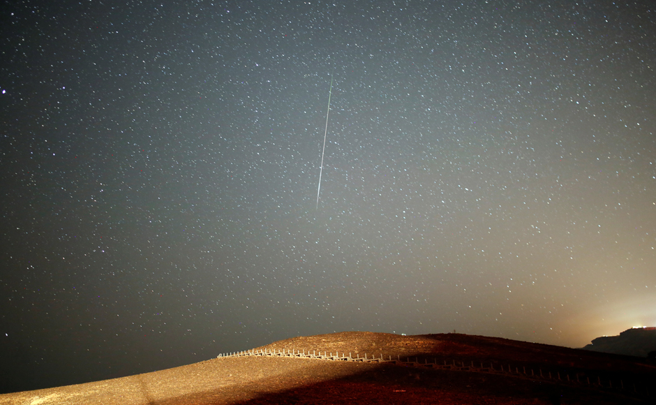 The Perseids happen when Earth hits a wide belt of debris left behind by the comet Tuttle-Swift on its elongated, 133-year orbit around the Sun. Reuters
