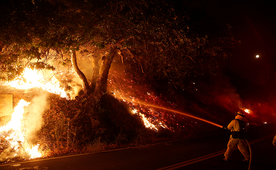 As many as eight wildland fires were burning in California on Wednesday, three of them scorching thousands of acres as firefighters sought help from emergency responders from other states and the California National Guard. Reuters