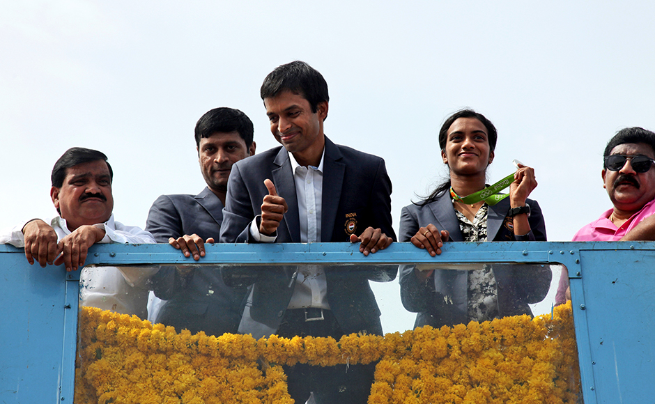 PV Sindhu waved to the cheering crowds from the open-top-motorcade as the procession completed its journey from the airport to the Gachibowli stadium, where the Telangana government had organised a gala felicitation in honour of the star shuttler. AP