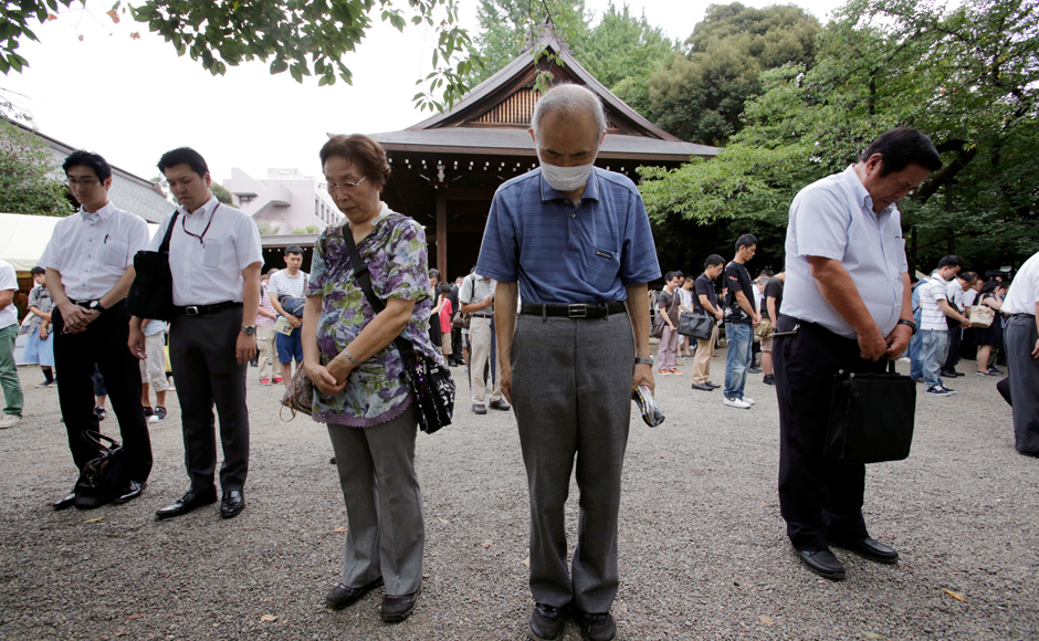 Visitors offer a silent prayer to the ward dead at Yasukuni Shrine in Tokyo Monday, Aug. 15, 2016. Japan marked the 71st anniversary of the end of World War II. AP