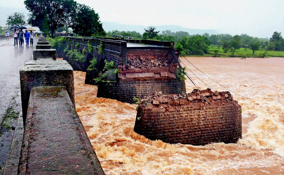 """Meanwhile, Maharashtra Chief Minister Devendra Fadnavis tweeted that the primary reason for the collapse seems to be """"the high pressure caused due to flooding of river Savitri due to heavy rains in the catchment of Mahabaleshwar."""" PTI"""