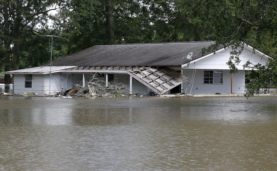 A flooded home is seen in St. Amant, Louisiana, U.S., August 15, 2016. REUTERS