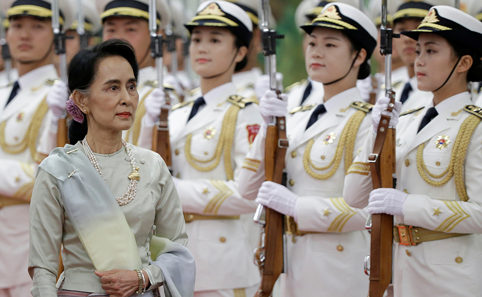 Myanmar State Counselor Aung San Suu Kyi reviews honour guards during a welcoming ceremony at the Great Hall of the People in Beijing, China, August 18, 2016. REUTERS