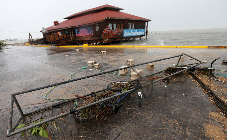 A bicycle and debris are seen along the beach, after Hurricane Earl hits, in Belize City, Belize. REUTERS/Henry Romero