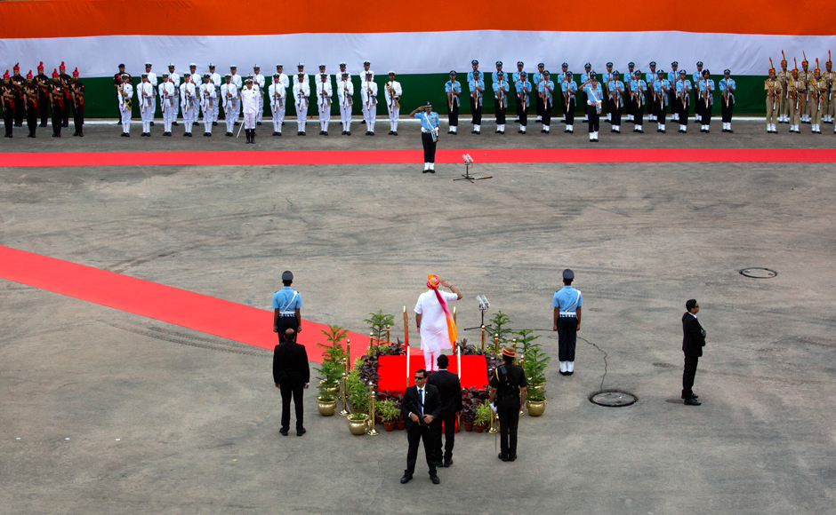 Indian Prime Minister Narendra Modi, centre in colored turban, inspects a guard of honor before addressing the nation from the ramparts of Red Fort to celebrate Independence Day in New Delhi, India, Monday, Aug. 15, 2016. India commemorated its Independence in 1947 from British colonial rule, on Aug. 15. AP