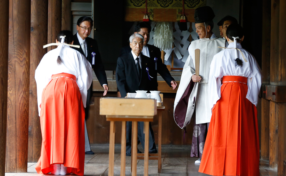 Japanese lawmakers walk after offering prayers to the war dead at the Yasukuni Shrine in Tokyo Monday, Aug. 15, 2016. Japan marked the 71st anniversary of the end of World War II. AP