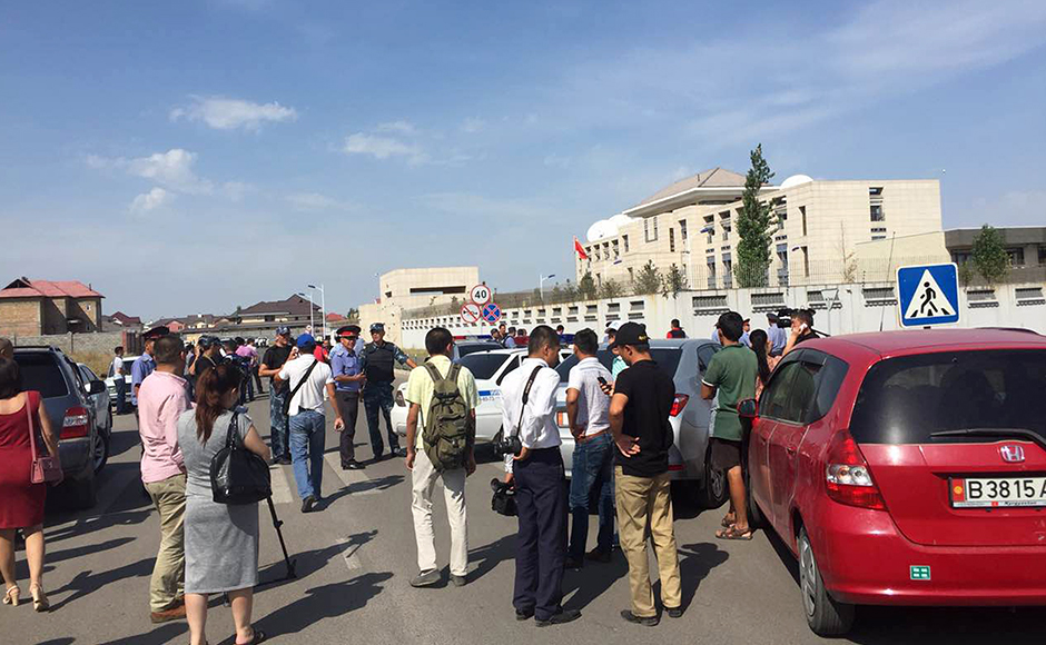 In this photo released by China's Xinhua News Agency, people gather near the site of an explosion in Bishkek, Kyrgyzstan, Tuesday, Aug. 30, 2016. Kyrgyzstan's deputy prime minister says a suicide bomber has rammed his car into the gate of the Chinese embassy compound in the capital Bishkek, detonating a bomb and injuring three embassy employees.AP