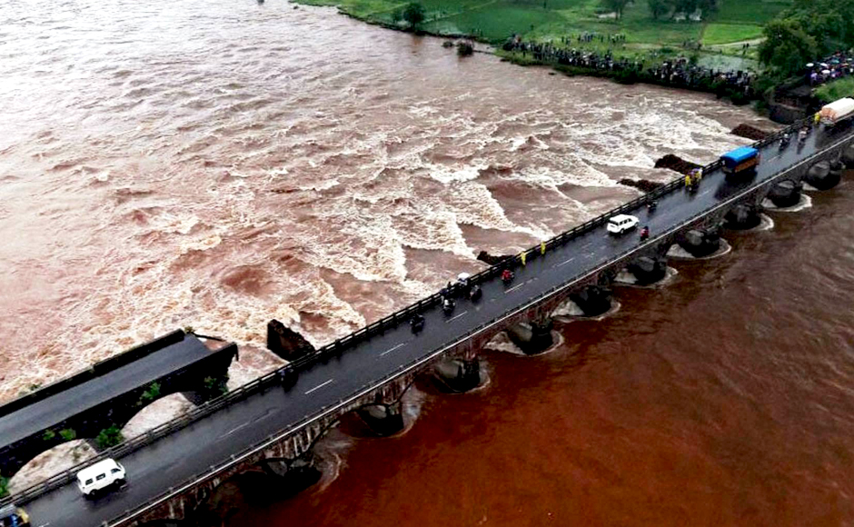 The remaining portion of Mahad-Poladpur bridge which was washed away in flood water of Savitri river. Chief Minister Devendra Fadnavis has announced a probe into the tragedy. PTI