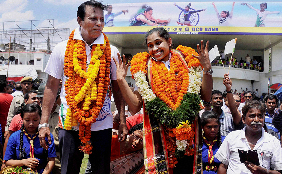 Gymnast Dipa Karmakar and her coach BS Nandi being accorded warm welcome upon their arrival at the airport in Agartala, Tripura on Monday after participating in Rio Olympics 2016.PTI