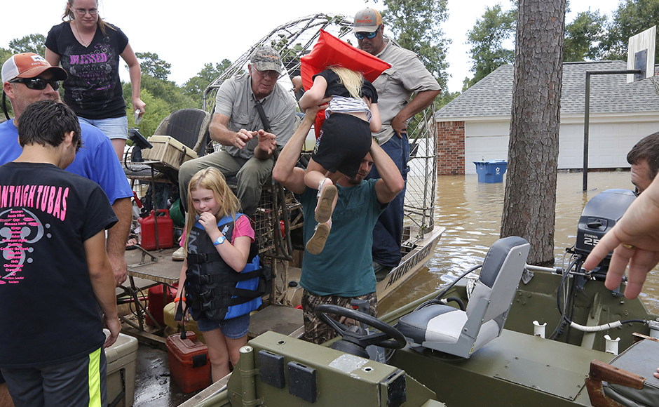 Residents are rescued in Ascension Parish, Louisiana, U.S., August 15, 2016. REUTERS