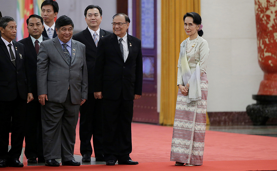 Myanmar State Counselor Aung San Suu Kyi (R) attends a welcoming ceremony at the Great Hall of the People in Beijing, China, August 18, 2016. REUTERS