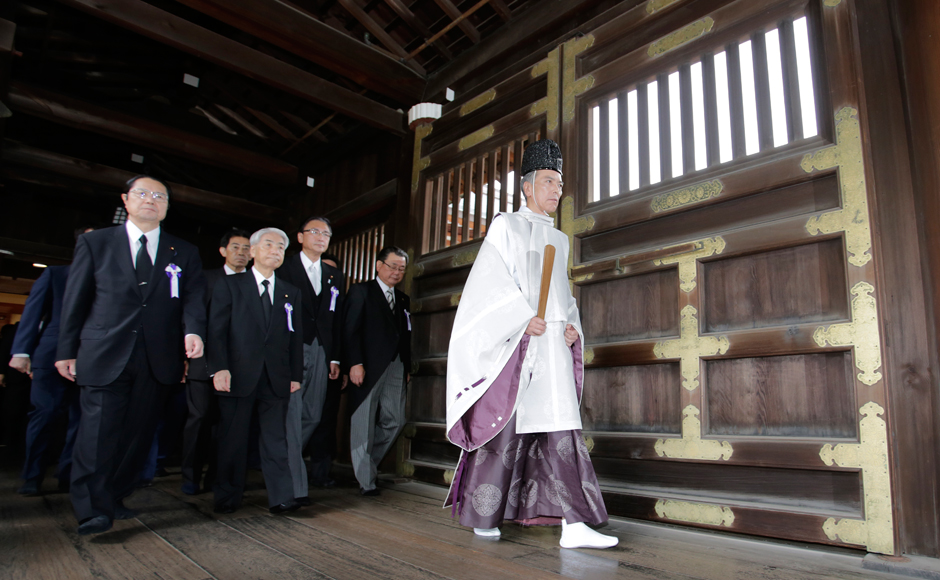 Japanese lawmakers visit the Yasukuni Shrine in Tokyo to offer prayers to the war dead Monday, Aug. 15, 2016. Japan marked the 71st anniversary of the end of World War II. AP