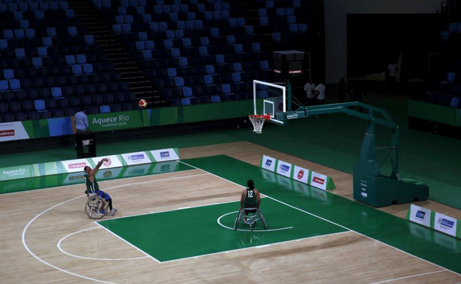 Paralympic athlete Leandro de Miranda (L) throws the ball during the presentation of the Arena Carioca 1 at the Rio 2016 Olympic Park in Rio de Janeiro. Arena Carioca 1 is the venue for basketball matches during the Rio 2016 Olympic Games. REUTERS/Pilar Olivares