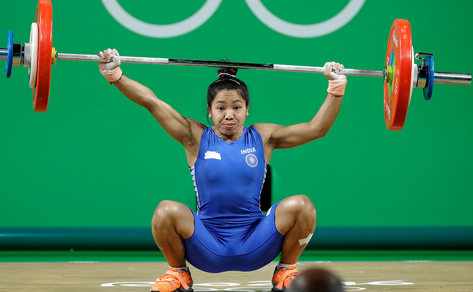 Chanu Saikhom Mirabai, of India, fails in an attempt in the women's 48kg weightlifting competition at the 2016 Summer Olympics in Rio de Janeiro, Brazil, Saturday, Aug. 6, 2016. (AP Photo/Mike Groll)