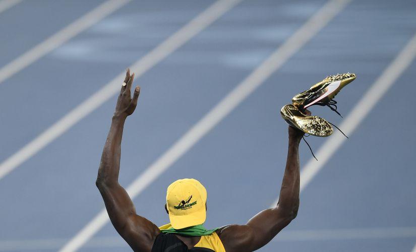 Usain Bolt celebrates winning the men's 100-meter final. AP