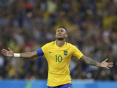Brazil's Neymar celebrates after scoring the decisive penalty kick. AP