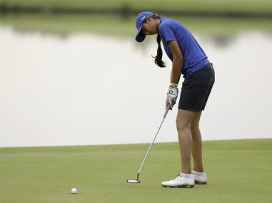 Aditi Ashok putts on the 2nd hole during the second round of the women's golf event. AP