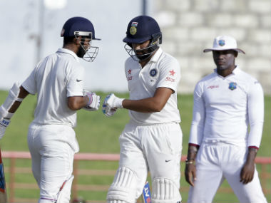 Ajinkya Rahane (left) and Rohit Sharma shared an unbroken 85-run stand for the fourth wicket. AP