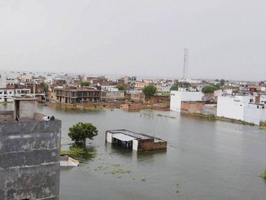 Submerged houses after heavy monsoon rain in Allahabad. Ganga river is flooded to an all time high. PTI