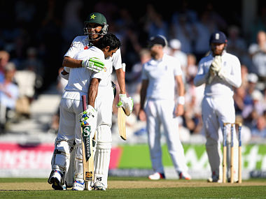 Asad Shafiq celebrates with Younis Khan after reaching his century. Getty