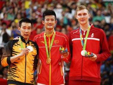 Lee Chong Wei (left, silver), Chen Long (middle, gold) and Viktor Axelsen (broze) pose with their respective medals after the conclusion of the men's singles event in badminton. Getty Images