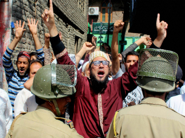 Curfew in Kashmir for 43rd day Govt staff asked to resume duties as protesters hit streets