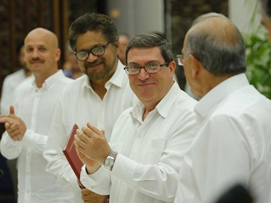 Cuban foreign minister Bruno Rodriguez (centre) applauds along with Humberto de La Calle (right) head of Colombia's government peace negotiation team, and Ivan Marquez (second left) chief negotiator of the Revolutionary Armed Forces of Colombia, after signing a peace agreement in Havana, Cuba on Wednesday.
