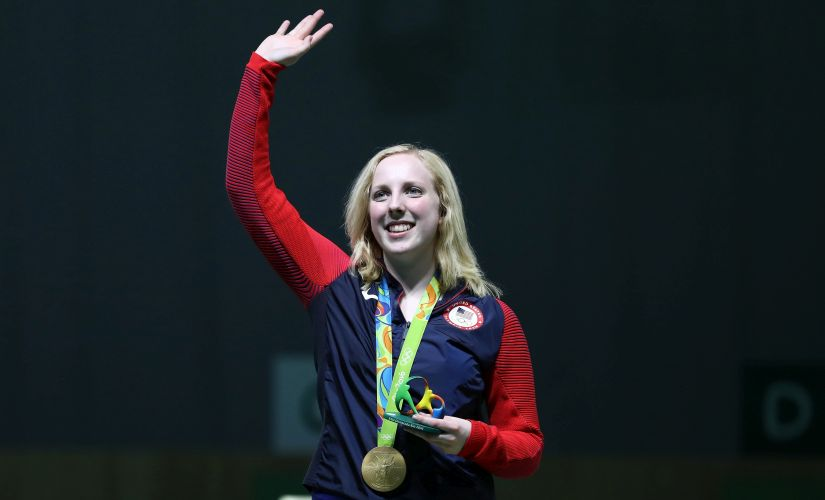 Virginia Thrasher waves after winning the gold medal in the 10m Air Rifle. Getty