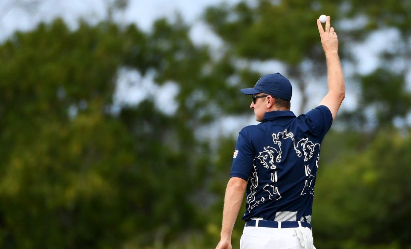 Justin Rose celebrates his hole in one on the fourth green during the first round of men's golf. Getty