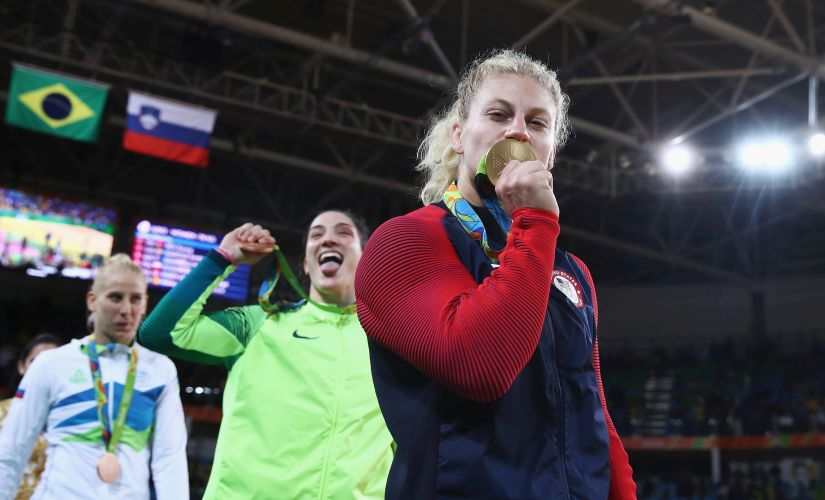 Kayla Harrison celebrates after defeating Audrey Tcheumeo. Getty
