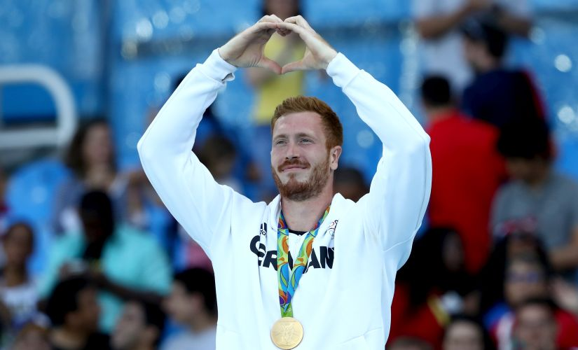 Gold medalist Christoph Harting poses on the podium during the medal ceremony. Getty